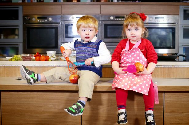 Connor and Lucia enjoying themselves in the kitchen